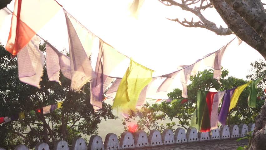 Buddhist prayer flags in the wind in Dambulla temple Sri Lanka | Shutterstock HD Video #1027314356