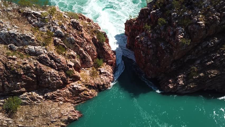 Aerial view of tidal rapids rushing through a canyon at the Horizontal Falls, Kimberley Region, Australia | Shutterstock HD Video #1027349348