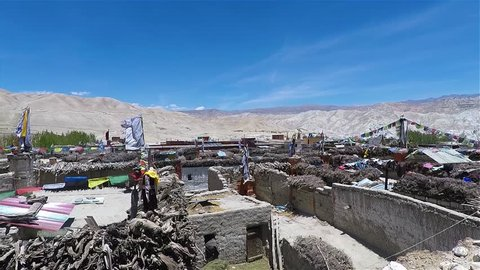 View of Lo Mantang and the mountains. Lo Mantang is the capital of the kingdom of Mustang. The city is in Tibet. The houses in the city are very old.