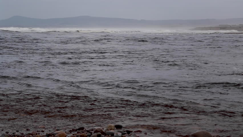 Tidal current from large river meeting the sea at an estuary in Scotland during a spring windy storm. Spey river and north sea.   Shutterstock HD Video #1027368869
