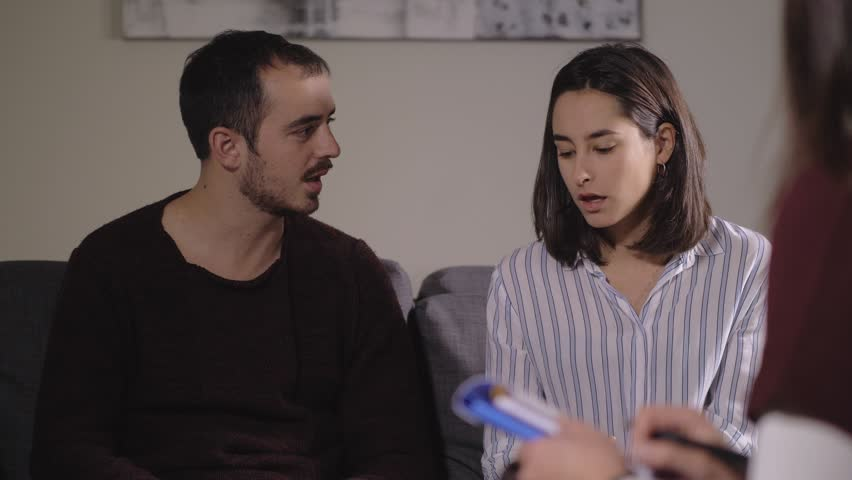 Young couple in crisis at the therapy psicological session-slow motion | Shutterstock HD Video #1027371578