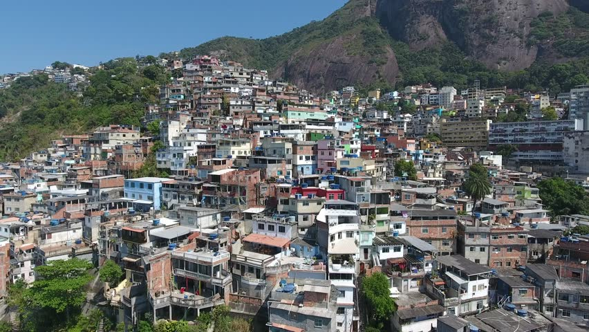 Aerial view of the houses of a favela in Rio de Janeiro, Brazil | Shutterstock HD Video #1027378928