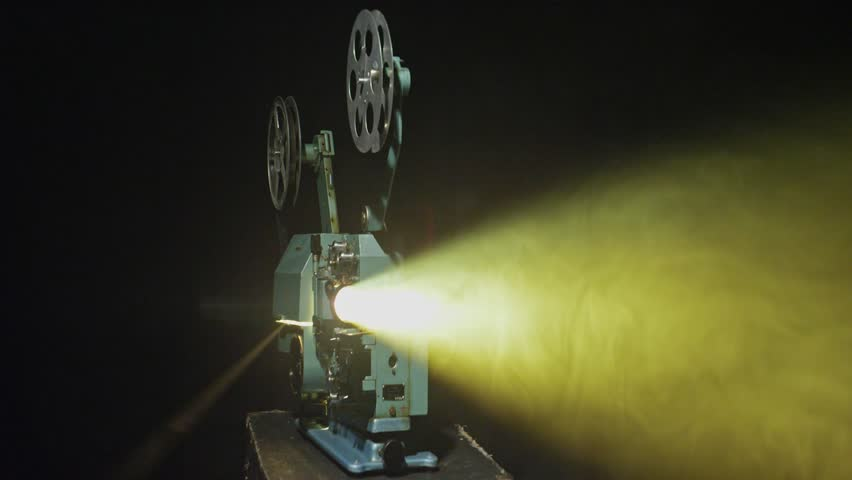 Old film projector shows a film, the lamp flashes and the film stops. #1027387166