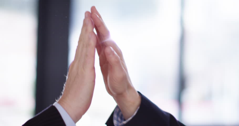 4K Business teamwork concept, close up on hands of man & woman giving a high five. Slow motion. Royalty-Free Stock Footage #1027405586