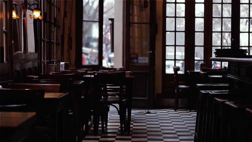 An Empty Traditional Cafe Notable in Buenos Aires, Argentina. Dust Particles Floating in the Air.