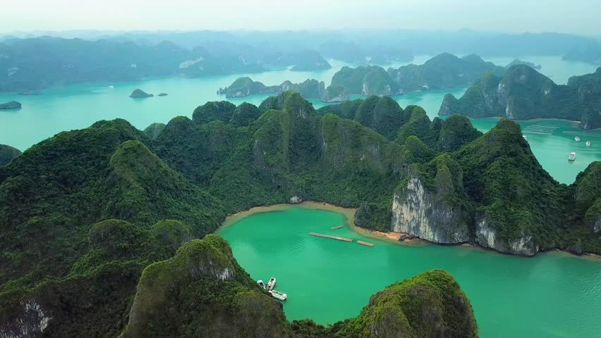 Helicopter tropical Ha Long Bay lot sharp natural rocks sea blue azure water. Wild natural untouched seascape horizon. Famous popular travel sight. Best Asia Vietnam. Drone