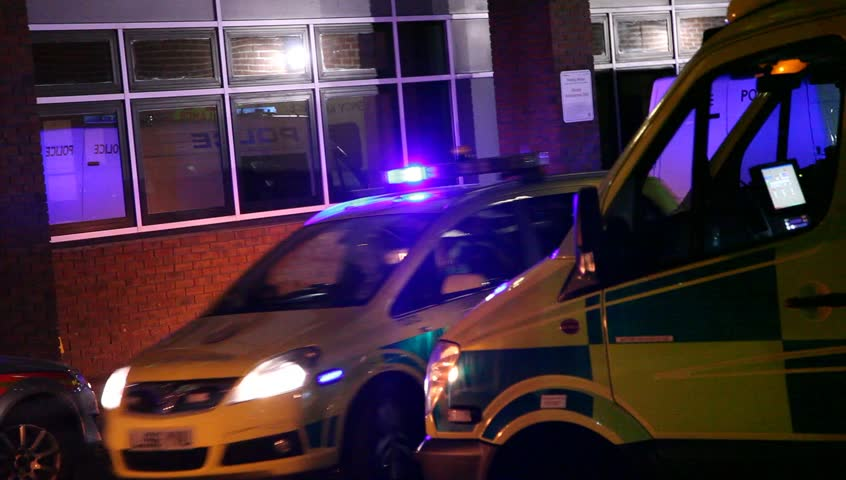 LONDON, UK - 2019: NHS Accident and Emergency exterior as police car flashes lights and leaves