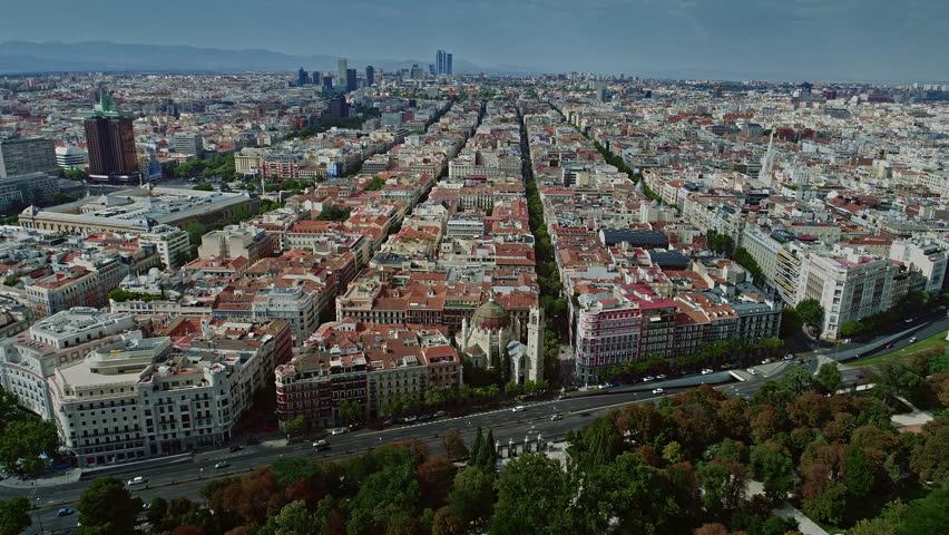 Aerial Drone Over Town Madrid Parque del Retiro Calle de Alcalá Torre Cepsa San Manuel y San Benito Church Spain 4k Royalty-Free Stock Footage #1027452044