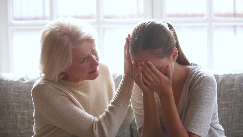 Loving sad old mother sympathizing consoling upset depressed young daughter crying desperate about problem, caring senior mom giving support understanding empathy to stressed adult woman in tears | Shutterstock HD Video #1027488479