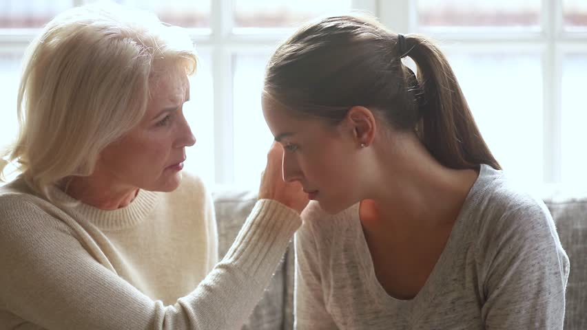 Understanding loving senior mother worried about upset young daughter having problem trust talk to caring old mom comforting consoling sad grown woman in trouble share problem with mature mum at home