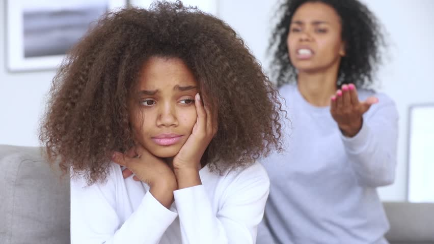 Sad teen african american girl upset by strict mum arguing scolding daughter, stressed stubborn teenager turned back ignoring angry black mother lecturing difficult kid, parent and children conflicts  Royalty-Free Stock Footage #1027488596