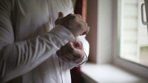 Man wearing white shirt in the morning