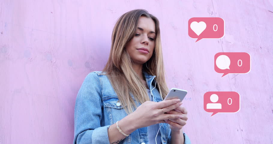Beauty Cute Influencer Girl Typing on Smartphone Summer Retro Looks with Pink Background Social Media Icons with Like Comment Follower Counter Quick Increase | Shutterstock HD Video #1027507055