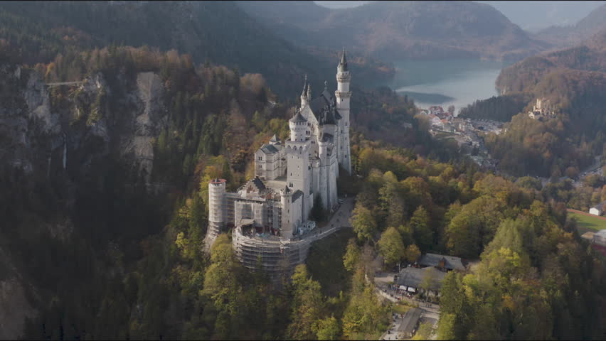 Aerial Neuschwanstein Castle, the famous Bavarian attraction, a nineteenth-century Romanesque Revival architecture, Hohenschwangau.