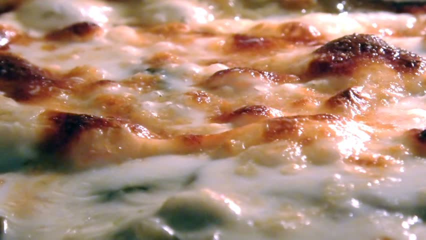 Baking Moussaka with vegetables and bechamel boiling in a oven. Close up view of cheese bubbles. Traditional greek dish. | Shutterstock HD Video #1027527083