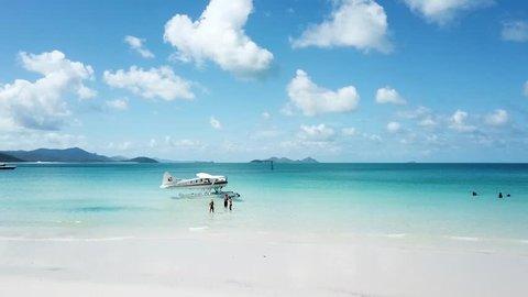 Enjoying Whitsundays in Australia. Drone shot of incredible beach and seaplane