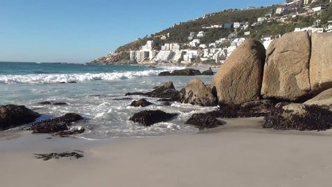 HD high quality summer afternoon video footage of spectacular Clifton Beach, rocks on shore, Atlantic Ocean white sand beach and mountain views in Western Cape near Cape Town, South Africa
