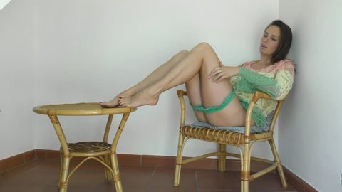 beautiful model with long legs posing for a video