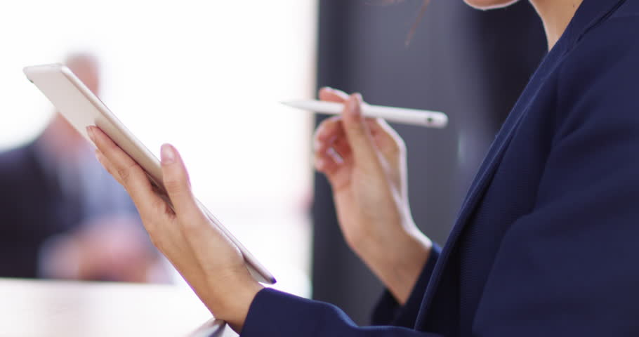 4K Unrecognizable businesswoman putting signature on tablet screen with stylus