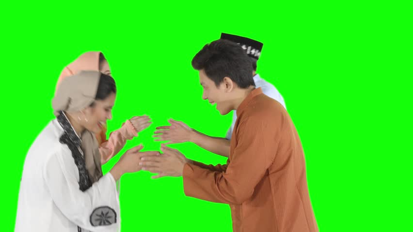 Group of attractive young muslim people forgiving each other by showing a greeting hands gesture in the studio. Shot in 4k resolution with green screen background | Shutterstock HD Video #1027591256