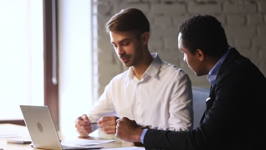 Happy male caucasian client customer partner handshake african broker insurer hr manager sign insurance job contract agreement take bank loan buy services shake hands make business deal at meeting Royalty-Free Stock Footage #1027633997