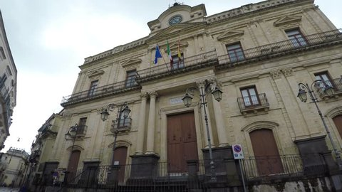4K Vizzini, Sicily, Italy April 2019:city hall building of Vizzini moving view and the beauty of its characteristic baroque architecture with  sky in background