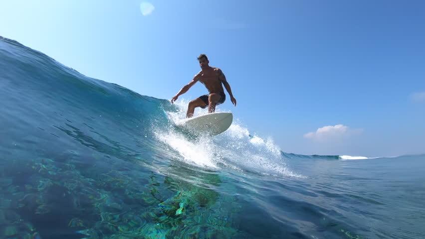 Hispanic surfer rides the glassy ocean wave #1027651244