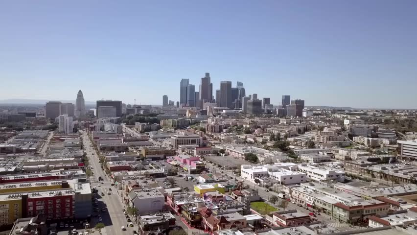Aerial view of Los Angeles reverse flyover North Broadway Street. | Shutterstock HD Video #1027652333