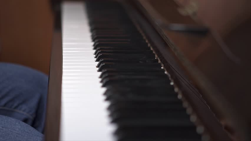 Musician plays piano, Close up shot with shallow depth of field   Shutterstock HD Video #1027661576