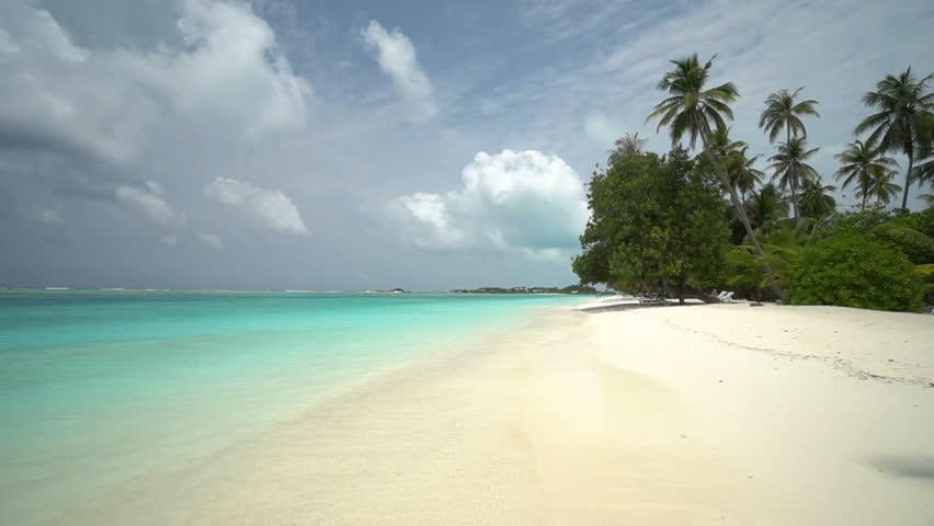 Picturesque tropical getaway in the beautiful Maldives Islands   Shutterstock HD Video #1027683371