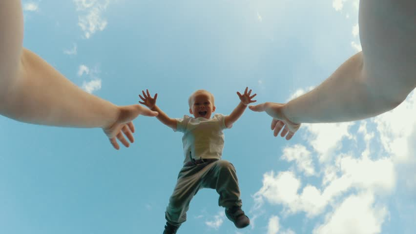 Father hands throw up little cute smiling son playing together clear blue sky in background POV shot happy family having fun outdoor relaxing at summer sunny day low angle   Shutterstock HD Video #1027693961
