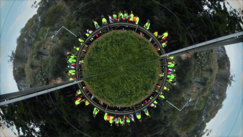 Crowd Running In Circles, Rotating Earth. Many people running in circular earth shape. Motion Background