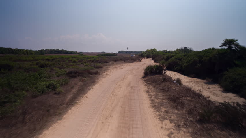 POV shot from a camera attached to the front of an off road vehicle driving through beautiful trails and paths in sardinia | Shutterstock HD Video #1027731293