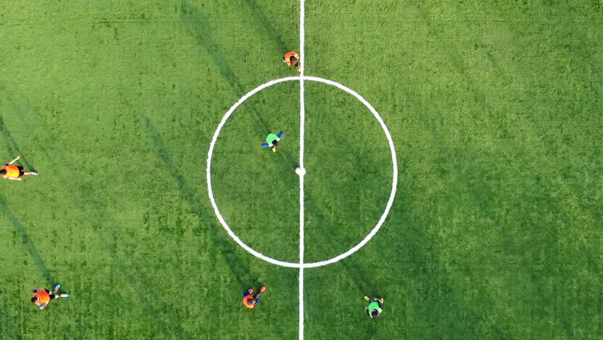 The beginning of a football match and scoring a Goal. Aerial shot of a football match the view from the top