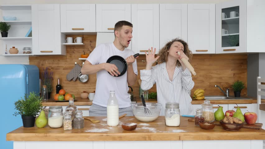 Family, Relationship, Happiness, Happy Lifestyle Concept. Couple Dancing In Kitchen. #1027789529