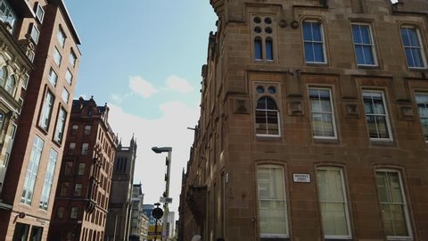 Glasgow, Scotland; April 13th 2019: Architectural detail of a building on the corner of Ingram Street and Brunswick Street in the Merchant City area. Tilt reveal of an unusual turret room at the top.