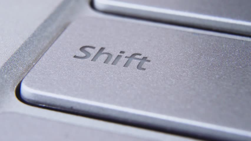 Extreme close-up of silver laptop keyboard. B-roll of macro computer key buttons. Concept of e-commerce and web business. Camera moving right #1027807166