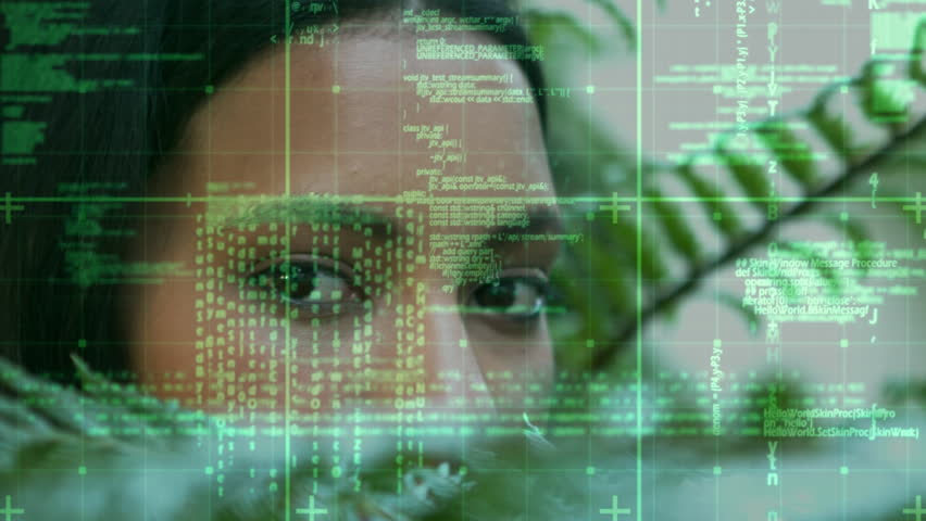 Digital composite of a young African-American woman staring while green data and statistics moves in the screen. | Shutterstock HD Video #1027819058