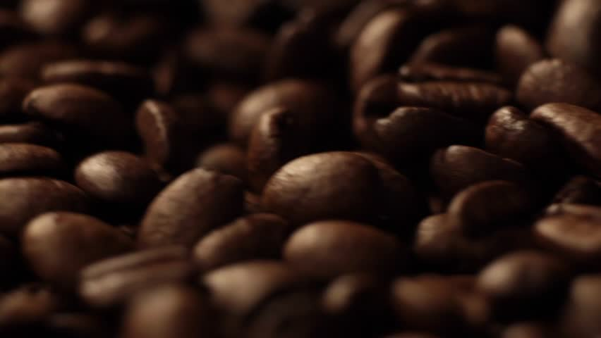 Dark Coffee Grains. Rotating and falling. Coffee beans. Close up of seeds of coffee. Beautiful seeds of coffee. | Shutterstock HD Video #1027839857
