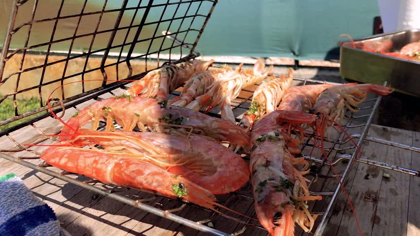 Closing grilling basket on jumbo shrimp or prawns, SLOW MOTION   Shutterstock HD Video #1027881383
