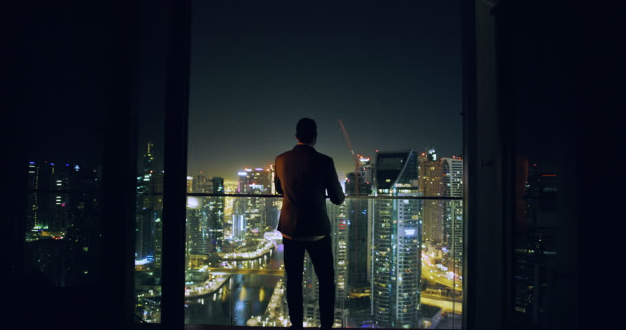 Young Entrepreneur Walkling Toward City Sky Scrapers Dubai Urban Panorama Futuristic Digital Nomad Night Downtown Slow Motion Red Epic 8k