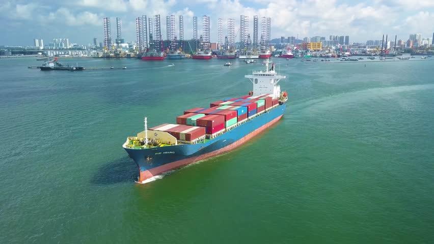 Singapore, West Coast Park - Feburary 9, 2019: Aerial shot of container ship leaving container port, Singapore