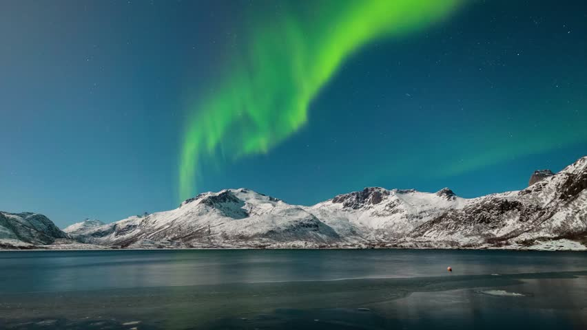 Aurora over the frozen lake in Lofoten, Norway.the Earth with green roof.