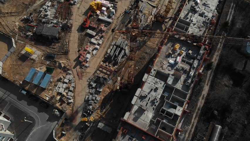 Drone flying over a construction site with a top down view. The camera flies superstructure, top-down view. Aerial view 4K | Shutterstock HD Video #1027897334