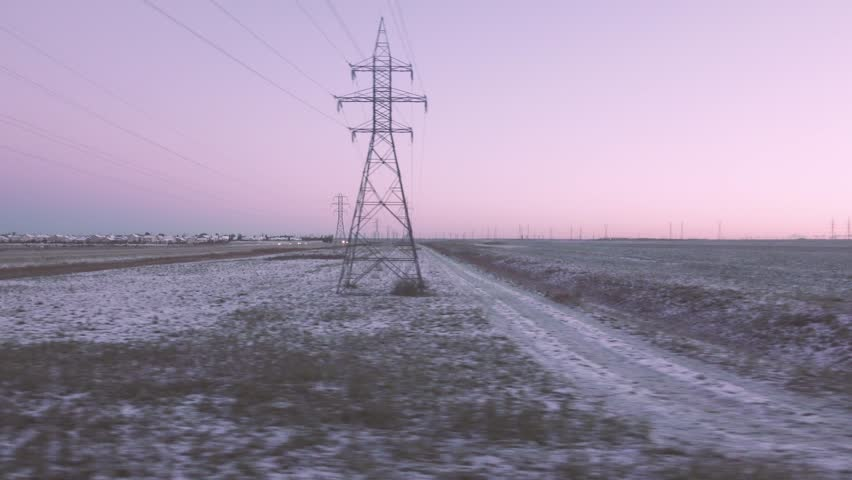 4K morning purple sky train view passing by electrical towers