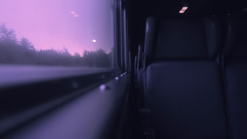 4K interior footage of a passenger train car looking through a window