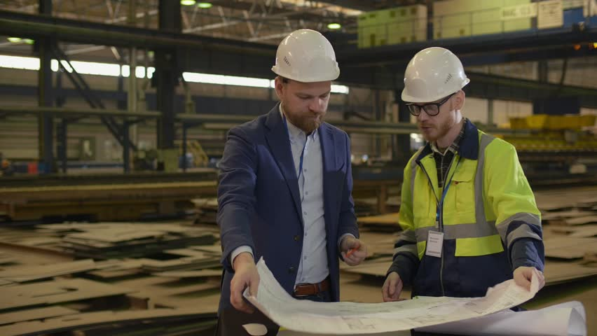 Plant manager and senior engineer shaking hands at the end of meeting in factory #1027919198