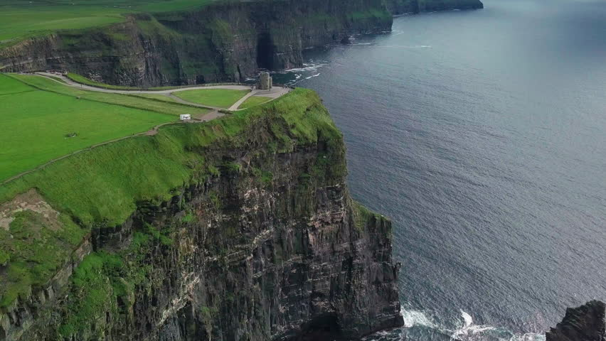 Aerial drone footage in 4k of the Cliffs of Moher in Ireland. Featuring a flight around O'Brien's tower. | Shutterstock HD Video #1027936271