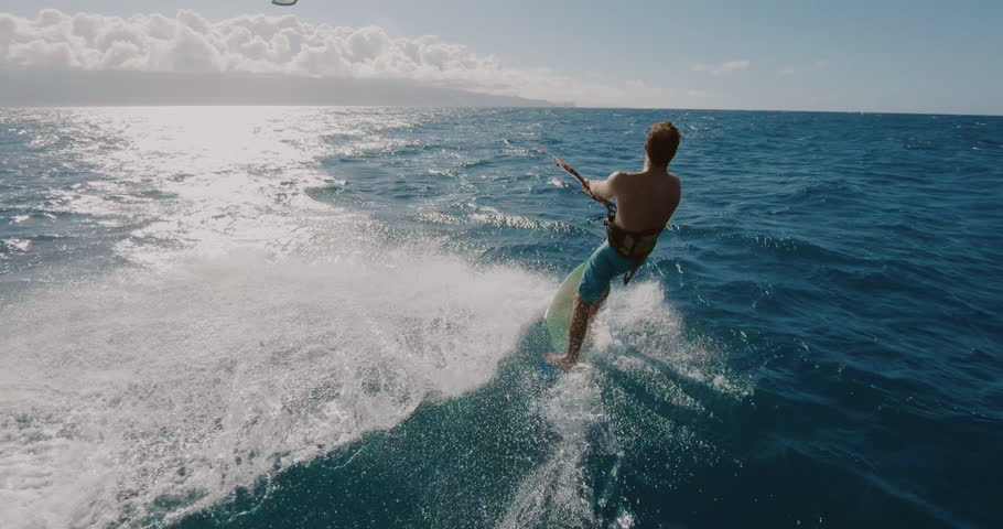 Young athletic man kitesurfing POV follow cam in slow motion, extreme action sports POV, tropical island surf adventure   Shutterstock HD Video #1027946264