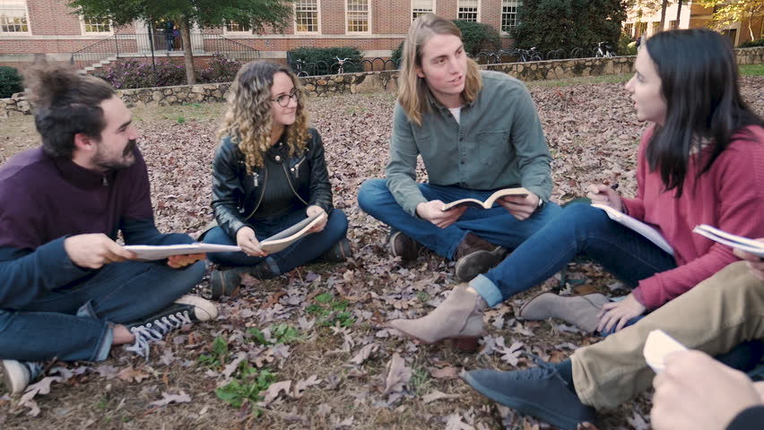 Male and female college students laughing and having fun outside studying together in a group with notebooks in slow motion Royalty-Free Stock Footage #1027951487